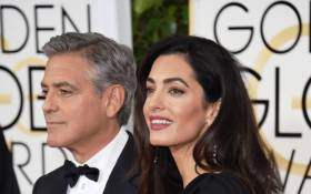Actor George Clooney and lawyer Amal Alamuddin Clooney attend the 72nd Annual Golden Globe Awards at The Beverly Hilton Hotel on 11 January, 2015. Picture: AFP.