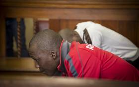 Convicted murderer Sifundo Mzimela looks up in the dock ahead of sentencing in the murder case of Mozambican national Emmanuel Sithole in the Johannesburg magistrate's court. Picture:Reinart Toerien/EWN