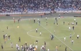 Kaizer Chiefs invaded the pitch and severely beat up a female security guard on Saturday night following the team's loss to the Free State Stars in the Nedbank Cup. Picture: Screengrab