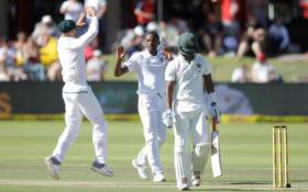 Proteas bowler Kagiso Rabada (C) celebrates the dismissal of Zimbabwean batsman Chamu Chibhabha (R) during the day two of the day-night Test match between South Africa and Zimbabwe at St George's Park in Port Elizabeth on 27 December, 2017. Picture: AFP
