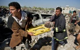 A screebgran picture shows people carrying an injured child in Yemen after Saudi-led air strikes in an ongoing war between the two countries.