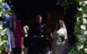 Britain's Prince Harry, Duke of Sussex and his wife Meghan, Duchess of Sussex emerge from the West Door of St George's Chapel, Windsor Castle, in Windsor on 19 May 2018 after their wedding ceremony. Picture: Ben Stansall/POOL/AFP
