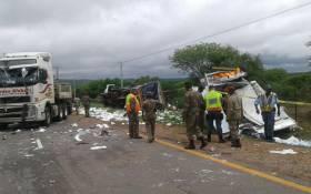 SANDF members and police investigate the crash scene. Picture: SAPS