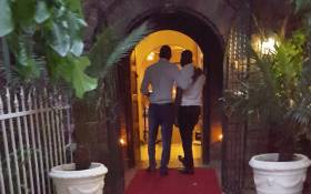 Eyewitness News journalists Clement Manyathela &  Victor Magwedze present themselves as a gay couple at the entrance of The Lake Restaurant in Brakpan. Picture: Louise McAuliffe/EWN.