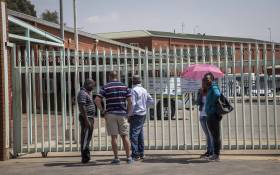 Families stand outside the Germiston mortuary, waiting for the bodies of their loved ones to be released, as an ongoing strike prevents operations. Picture: Thomas Holder/EWN