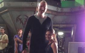 Neil Fingleton with Mila Kunis on the set of Jupiter Ascending. Picture: @NeilFingleton/Twitter.
