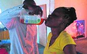 A screengrab showing Prophet Rufus Phala giving one of his church members Dettol. Picture: Facebook.com.