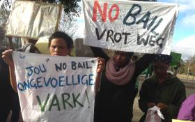 Community members brandishing posters outside court at the Rene Roman murder trial. Picture: Lauren Isaacs/EWN