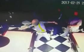 This screengrab shows a man falling to the ground after he was struck in the eye with a pool cue at Mitzy's Biker Bar, Alberton. Police are looking for the assailant.