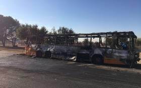 A burnt Putco bus on the street following this morning's violent protest. Thando Khubega/EWN.