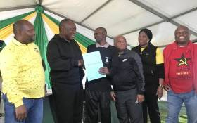 ANC President Cyril Ramaphosa hands over title deeds at the KZN Thuma Mina campaign launch. Picture: MYANC/Twitter.