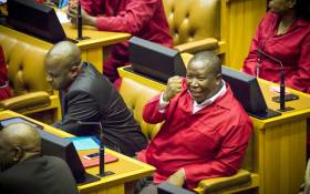 FILE: EFF leader Julius Malema gesticulates jokingly to a fellow member of the house during the Sona2015 debate. Picture: Thomas Holder/EWN.