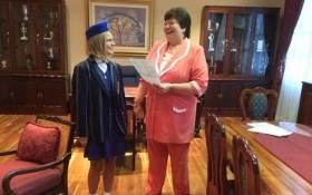 The 2014 Gauteng's top matriculant Sigourney Lishman's receiving her certificate. Picture: Barry Bateman/EWN.