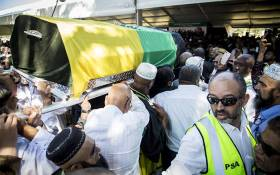 Draped in the flag of the ANC, the coffin of late struggle stalwart Ahmed Kathrada at his official state funeral at West Park cemetery, Johannesburg on 29 March. Picture: Reinart Toerien/EWN.