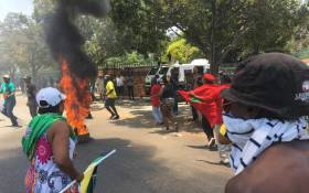 EFF and ANC protesters burn tyres at the Hoërskool Overvaal in Vereeniging on 17 January 2018. Picture: EWN