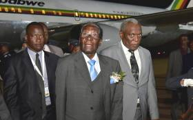 Telecommunications and Postal Services Minister Siyabonga Cwele recceives Zimbabwean President Robert Mugabe on his arrival at Waterkloof Airforce Base in Pretoria. Picture: GCIS.