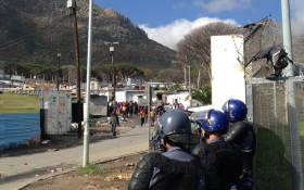 FILE: Law enforcement officials monitoring the situation in Imizamo Yethu following protests by angry residents. Picture: Bertram Malgas/EWN