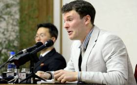 This file photo taken on 29 February 2016 and released by North Korea's official Korean Central News Agency (KCNA) on 1 March 2016 shows US student Otto Frederick Warmbier (R), who was arrested for committing hostile acts against North Korea, speaking at a press conference in Pyongyang. Picture: AFP