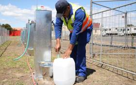 A City of Cape Town official shows the media how the Day Zero Water Station works. Picture: Bertram Malgas/EWN