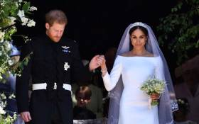 FILE: Britain's Prince Harry, Duke of Sussex and his wife Meghan, Duchess of Sussex emerge from the West Door of St George's Chapel, Windsor Castle, in Windsor, on 19 May 2018 after their wedding ceremony. Picture: AFP.