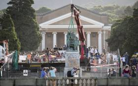 The statue of Cecil John Rhodes is being removed from the University of Cape Town on 9 April 2015. Picture: Aletta Gardner/EWN