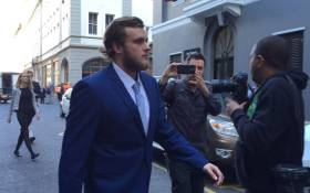 Henri van Breda leaves the Western Cape High Court after a brief appearance on 9 September 2016. Picture: Monique Mortlock/EWN.