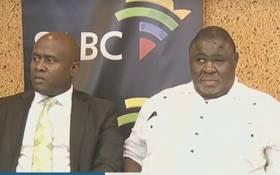 A screengrab of SABC acting CEO James Aguma and SABC board chairperson Mbulaheni Maguvhe at a press briefing.