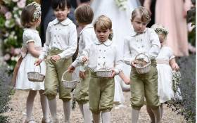 Prince George (front row centre) at the wedding of his aunt Pippa Middleton to James Matthews on 20 May 2017. Picture: AFP.