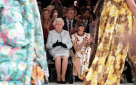 Britain's Queen Elizabeth II, accompanied by British-American journalist and editor, Anna Wintour (R), views British designer Richard Quinn's runway show before presenting him with the inaugural Queen Elizabeth II Award for British Design on 20 February 2018. Picture: AFP