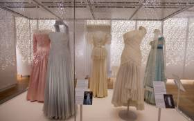 Dresses made by desinger Catherine Walker in 1987 (2L), and Gina Fratini in 1990 (2R), worn by worn by Britain's Diana, Princess of Wales in Hong Kong in 1989. Picture: AFP
