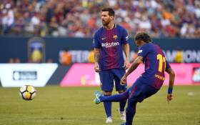 Barcelona's Argentinian forward Lionel Messi (L) looks on as Barcelona's Brazilian forward Neymar kicks the all during the International Champions Cup (ICC) match between Juventus FC and FC Barcelona on 22 July 2017. Picture: AFP.