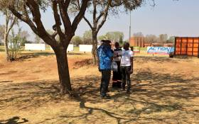 Forensic investigators sift through potential evidence at the Laudium Oval stadium where two young men were shot dead and two others critically wounded. Picture: Katleho Sekhotho/EWN