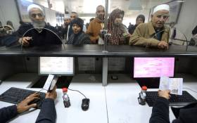 Libyan border police check passengers arriving at Mitiga airport a few days after militiamen attacked it in an attempt to free colleagues held at a jail there, on the outskirts of the capital Tripoli, on 20 January 2018. Picture: AFP.