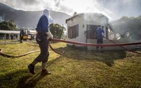 Firefighters douse one of the cottages which caught fire at Oatlands Holiday Village in Simon's Town on 19 November 2015. Picture: Aletta Harrison/EWN