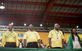 President Jacob Zuma, Cyril Ramaphosa, Zweli Mkhize and Baleka Mbete sing the national anthem at the ANC's 54th national conference. Picture: Thomas Holder/EWN.