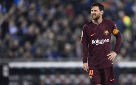 Barcelona's Argentinian forward Lionel Messi grimaces after missing a penalty kick during the Spanish 'Copa del Rey' (King's cup) quarter-final first leg football match between RCD Espanyol and FC Barcelona at the RCDE Stadium in Cornella de Llobregat on 17 January, 2018. Picture: AFP.