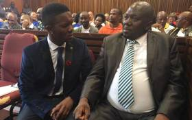 Rethabile Mlotshwa with his lawyer ahead of proceedings inside the Middelburg Magistrates Court during the sentencing of Theo Jackson and Willem Oosthuizen on 23 October 2017. Picture: Ziyanda Yono/EWN.