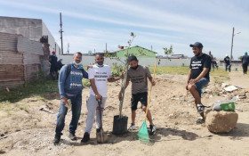 Addicts in recovery give back by helping to clean up their local community