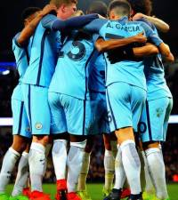 Unstoppable City break record, United edge out Bournemouth