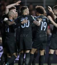 Man City survive late fightback to reach League Cup final