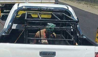 EC man explains caged woman on back of his bakkie