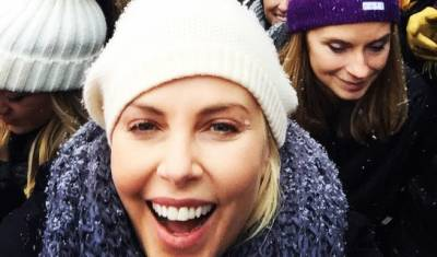 Charlize Theron joins celebrities at Sundance Women's March