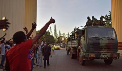 Gambians celebrate as West African troops enter capital after Jammeh flees