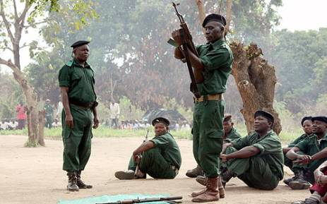 A file picture taken in Gorongosa's mountains shows fighters of former Mozambican rebel movement Renamo receive military training. Jinty Jackson/AFP