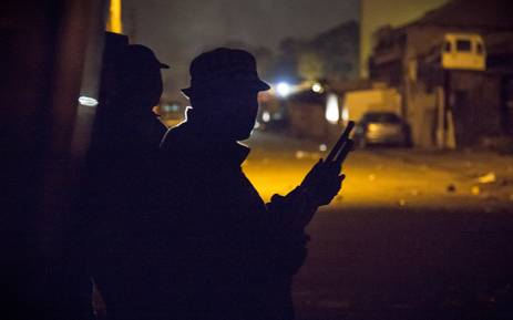 """A plain clothes policeman stands at the ready during raids in Alexandra township amid violence sparked by xenophobic attacks in April 2015. Picture: Thomas Holder/EWN"""""""