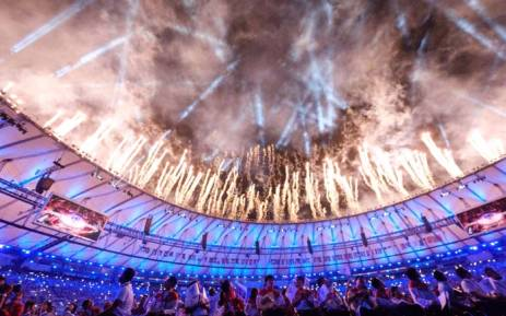 Athletes watch a fireworks display during the closing ceremony of the Rio 2016 Paralympic Games at the Maracana stadium. Picture: AFP.