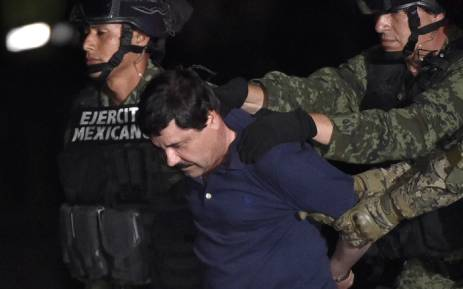 "Drug kingpin Joaquin ""El Chapo"" Guzman is escorted into a helicopter at Mexico City's airport on 8 January, 2016 following his recapture during an intense military operation in Los Mochis, in Sinaloa State. Picture: AFP"