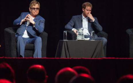 FILE: British singer Elton John and Britain's Prince Harry attend the International Aids Conference at the international convention centre in Durban on 21 July, 2016. Picture: AFP
