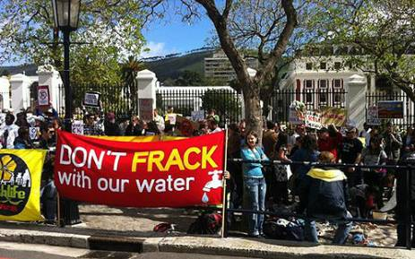 Protesters gather outside Parliament to show their opposition to the government's decision to lift a moratorium on shale-gas exploration in the Karoo. Picture: Nathan Adams/EWN