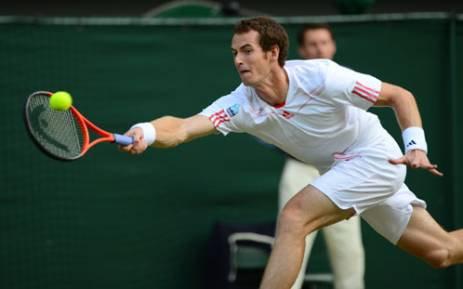 Britain's Andy Murray plays a forehand shot during his men's singles semi-final match against France's Jo-Wilfried Tsonga on day 11 of the 2012 Wimbledon Championship. Picture: AFP.